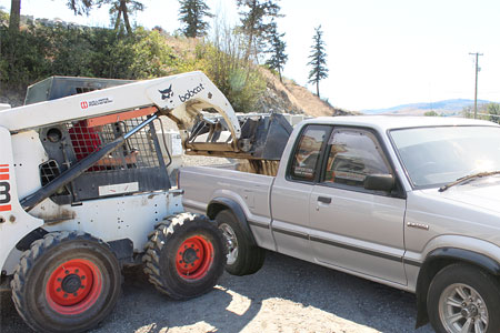 Bobcat Loading Pickup Truck